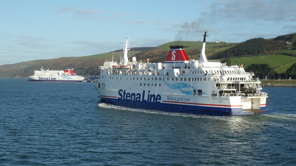 Old and New(er)! STENA NAVIGATOR approaches one of the ships which was to replace her, STENA SUPERFAST VII, seen here berthed at Loch Ryan Port. Coincidentally, STENA NAVIGATOR had been displaced on the Dover - Calais route by another Superfast VII class ship, SEAFRANCE MOLIERE, the former Superfast X and present STENA SUPERFAST X. Copyright © Scott Mackey.