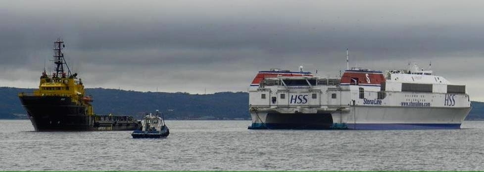 HSS Stena Voyager being towed from Belfast stern first by the tug Agat in 2013. Copyright © Scott Mackey.