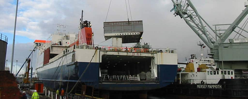 The floating crane MERSEY MAMMOTH (now LARA I lifts part of the new additional passenger accommodation module onto BEN-MY-CHREE in mid-January 2004. Copyright © Cammell Laird.