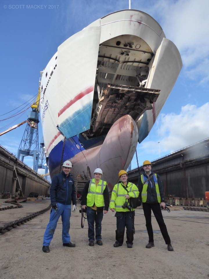 Pictured with Stena Superfast VII in dry dock at Harland and Wolff are Capt Alistair McCarlie (Senior Master), enthusiasts and photographers Steven Tarbox, Marty McVicker and Ross McDonald. Copyright © Scott Mackey.