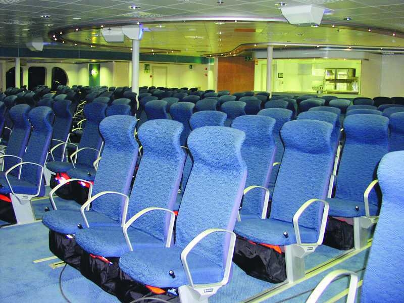 'Airline' seating onboard WESTPAC EXPRESS when she was a military vessel. US Military Sealift Command.