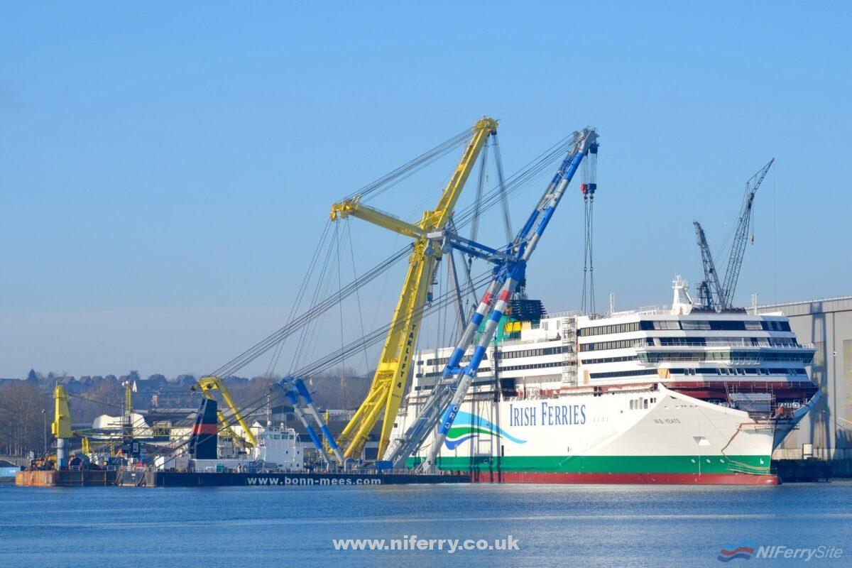 Irish Ferries W.B. Yeats shown under construction at the Flensburger shipyard on 8th February 2018. The heavy-lift crane barges MATADOR and TAKLIFT have competed the lifting of the last section of superstructure into place in this view. Copyright © Frank Jensen.