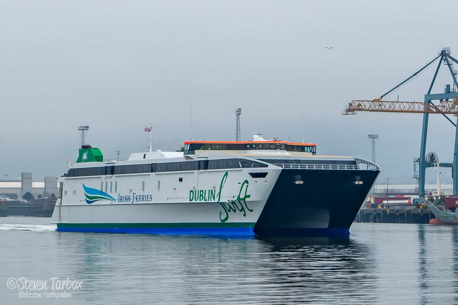 Irish Ferries' Austal AutoExpress catamaran DUBLIN SWIFT passes Beflast's Victoria Terminal 3 container terminal as she leaves Belfast for Dublin. This followed the conclusion of a comprehensive 3-month long refit and conversion project at Belfast's Harland & Wolff Shipyard