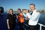 Anna Bunney, ORCA's Education Coordinator, is pictured with Gavin McDermott, second officer, and Captain Paul Roche on board P&O Ferries' European Causeway, during training ahead of ORCA OceanWatch Week.