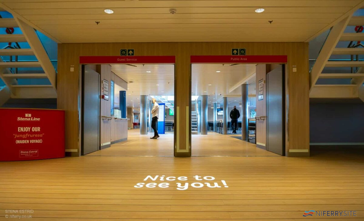 """Entrance lobby. """"Nice to see you"""" is projected onto the floor from the deckhead above. © NIferry.co.uk"""