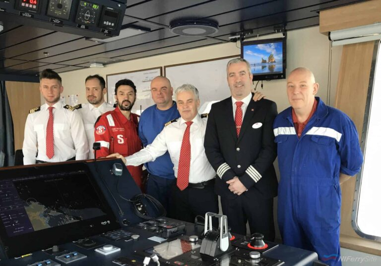 Some of STENA EDDA's delivery crew join Senior Master Captain Neil Whittaker (white shirt, centre) on the bridge to mark the start of her delivery voyage to the UK. Stena Line.