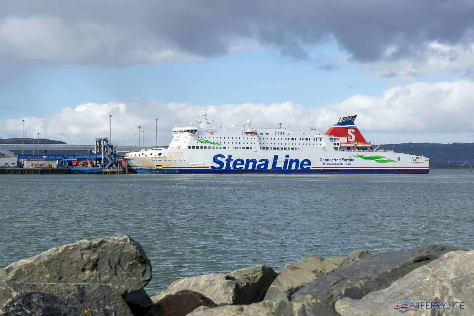 STENA SUPERFAST X prepares to discharge her cargo for the list time in Stena Line service. The ship would later leave Belfast for Greece ahead of starting a new life as an overnight ferry between France and Africa. Copyright © Steven Tarbox / niferry.co.uk.