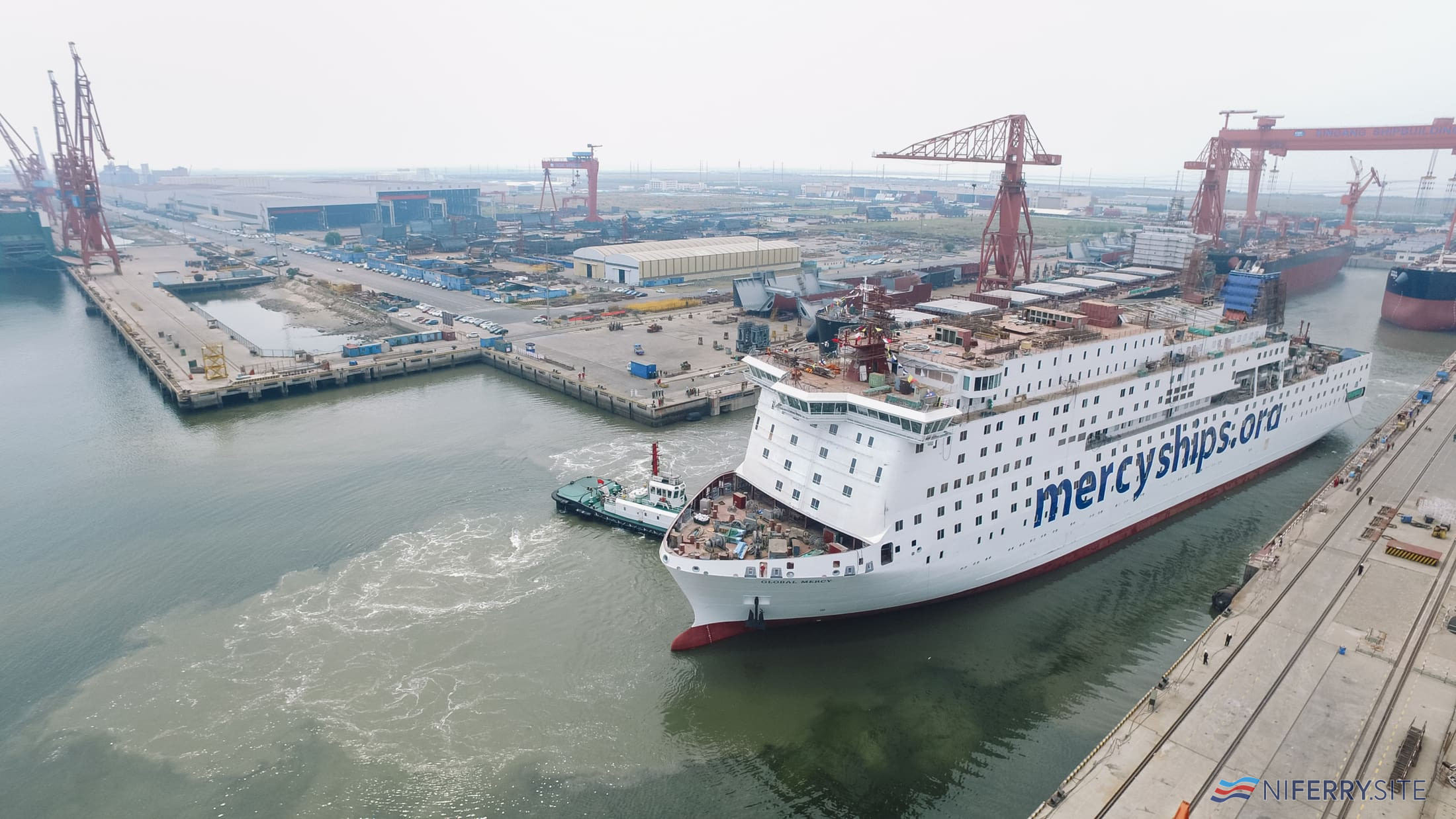 The Global Mercy changing berths after being painted. Stena RoRo