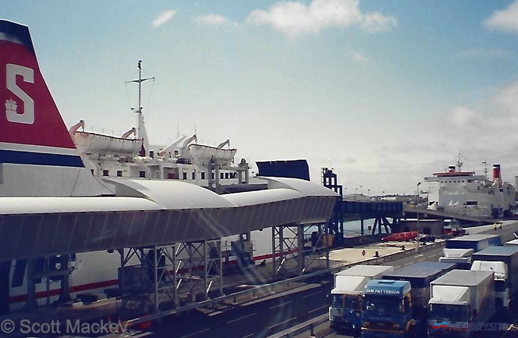 Stena Galloway and Stena Antrim viewed from the departure lounge in the new terminal building while cars wait to board the HSS Stena Voyager, July 1996. © Scott Mackey.